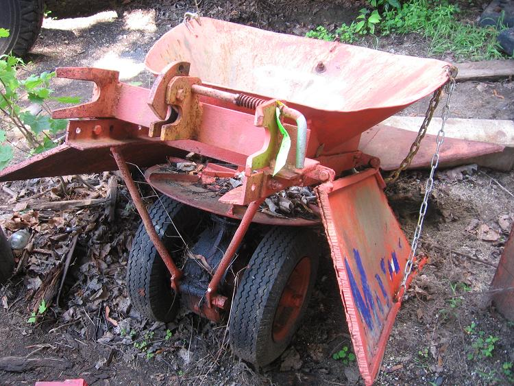 http://www.badgoat.net/Old Snow Plow Equipment/Plow Equipment/Snow Plow Manufacturers/Wall Spreader Truck/GW750H563-4.jpg